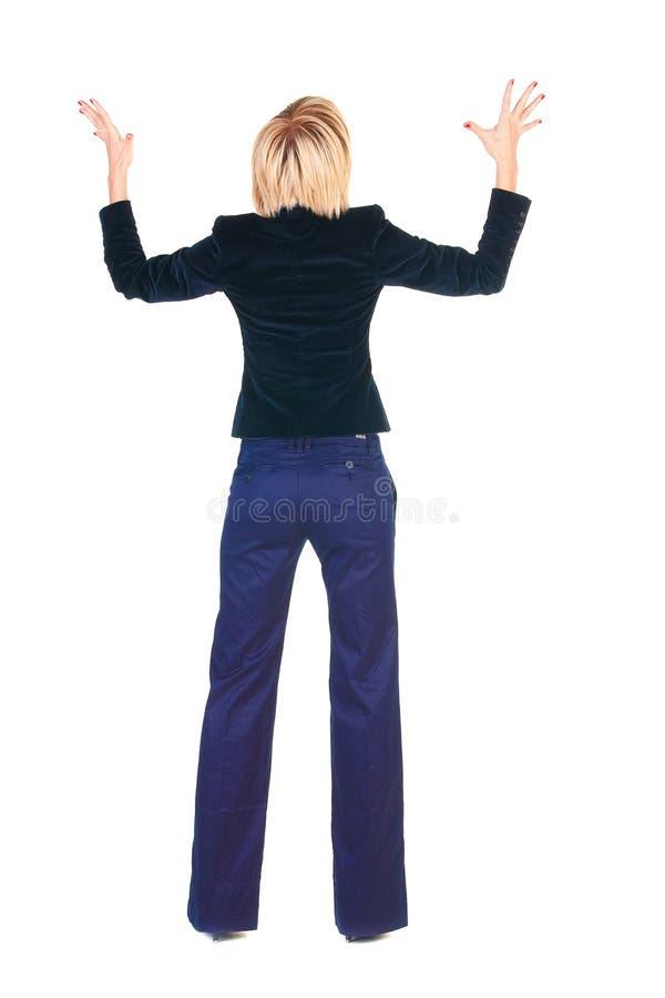 Entsetzte blonde Geschäftsfrau. Hintere Ansicht. lizenzfreies stockbild