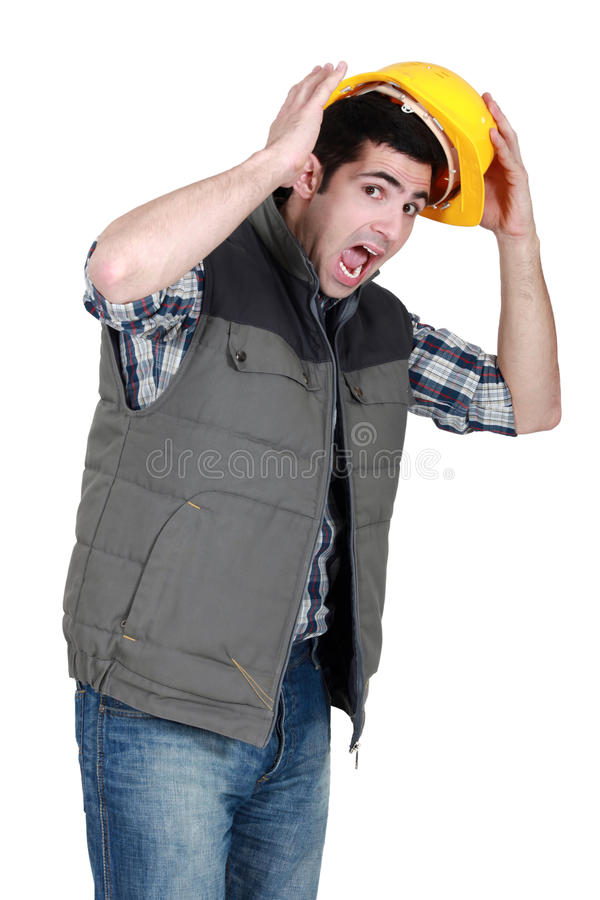 Entsetzter Bauarbeiter lizenzfreie stockbilder