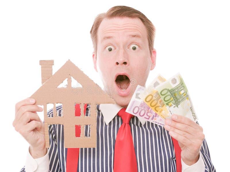 Entsetzter Geschäftshauseigentümer mit Geld lizenzfreie stockbilder
