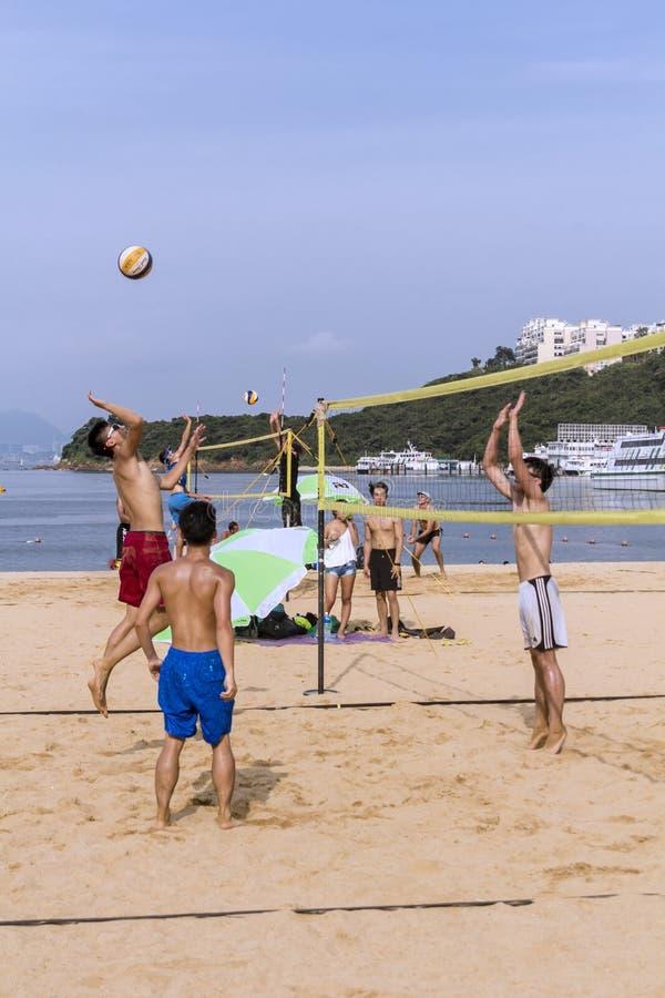 Entspannender Sport der Strand-Salve auf dem Strand lizenzfreie stockfotos