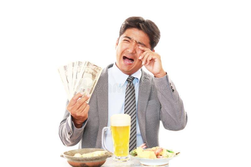 Enttäuschter asiatischer Geschäftsmann stockfoto