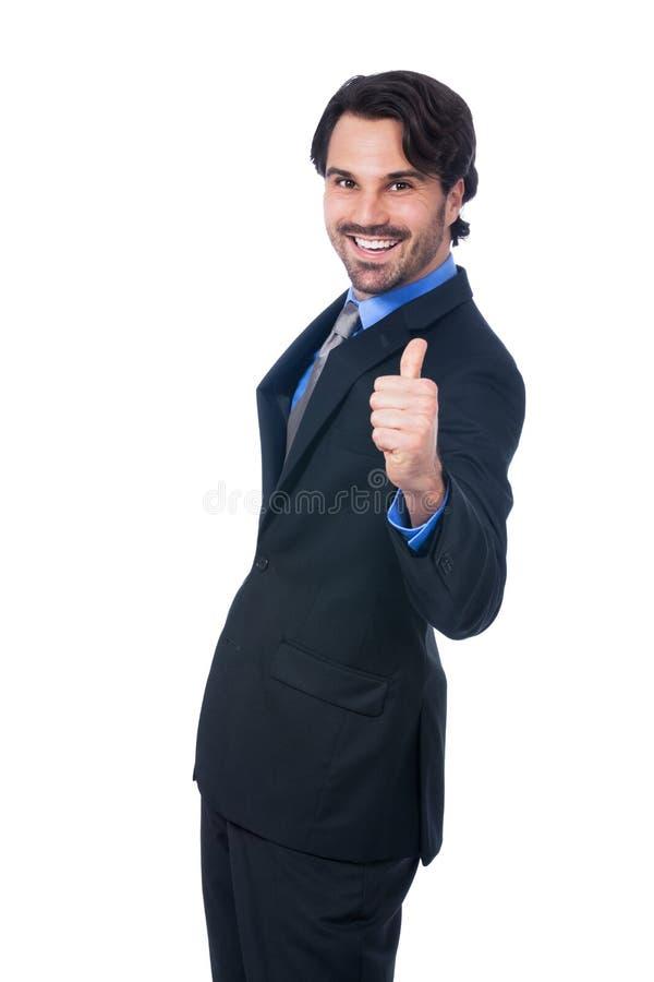 Entusiastiskt ge sig för affärsman tummar upp arkivbild