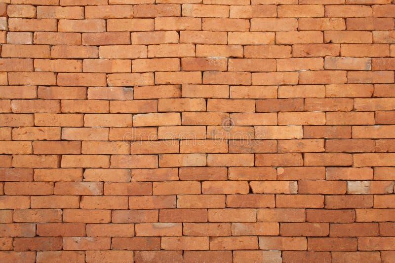 Entwerfen Sie auf orange Backsteinmauer für Muster und Hintergrund lizenzfreie stockfotografie