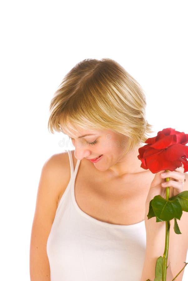 Entzückende Frau mit Blumen stockfotos