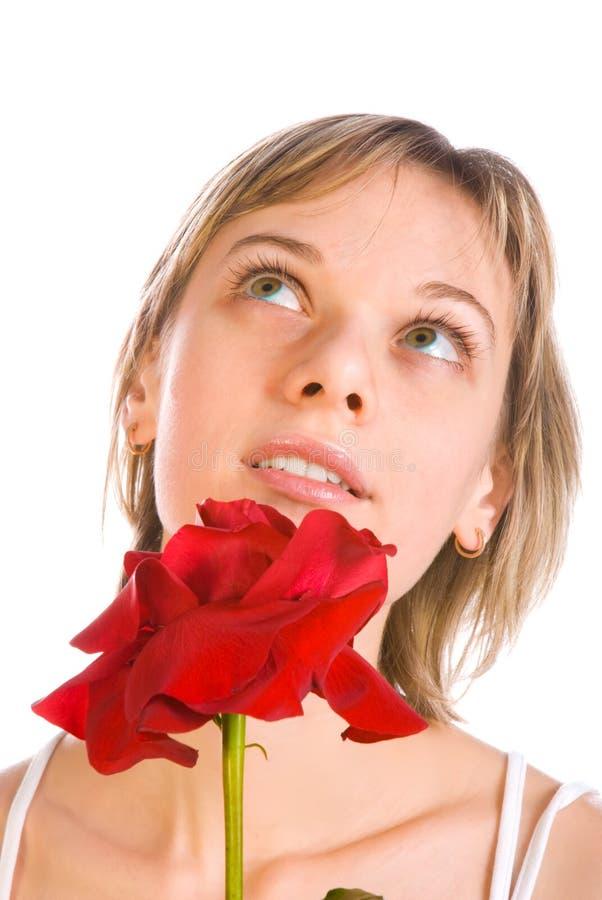 Entzückende Frau mit Blumen stockbild