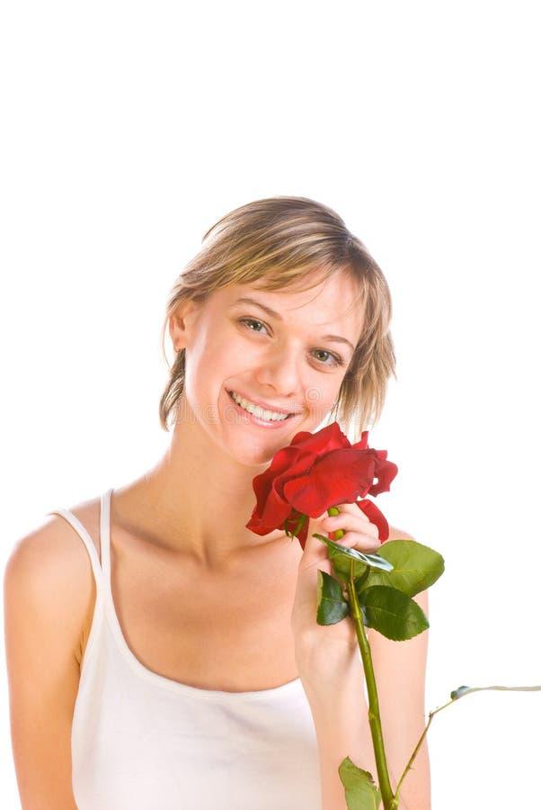 Entzückende Frau mit Blumen lizenzfreie stockfotografie