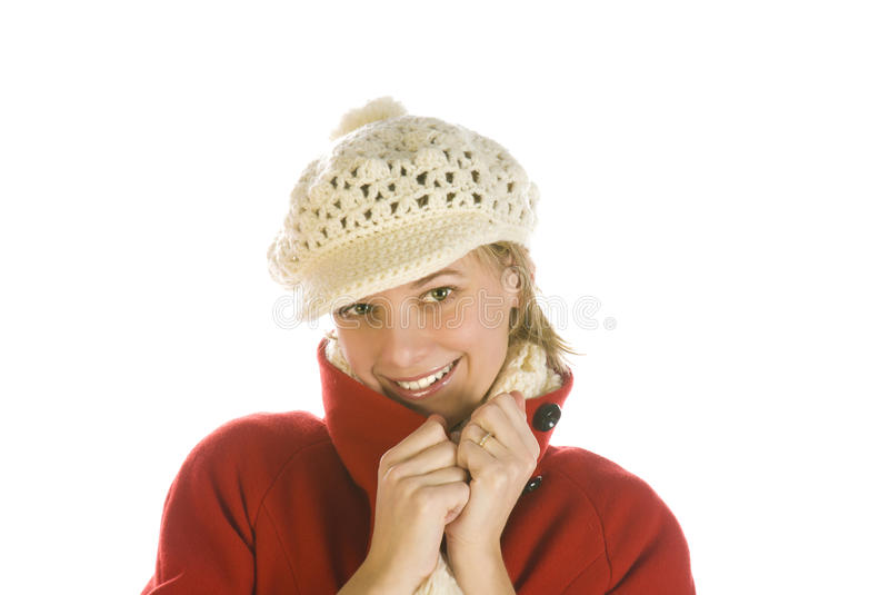Entzückende junge Frau in einer Winterschutzkappe lizenzfreies stockbild