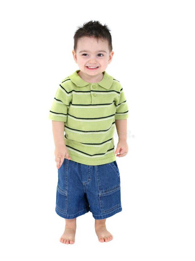 Entzückender Junge in den grünen Streifen stockfotografie