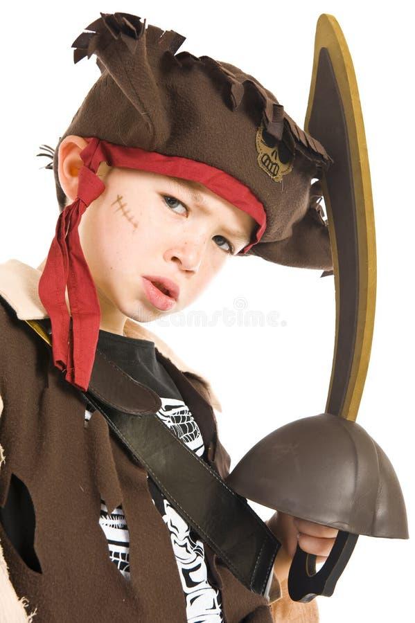 Entzückender Junge im Piratenkostüm lizenzfreie stockfotografie
