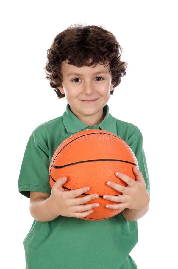 Entzückender Junge mit Kugel stockfotos