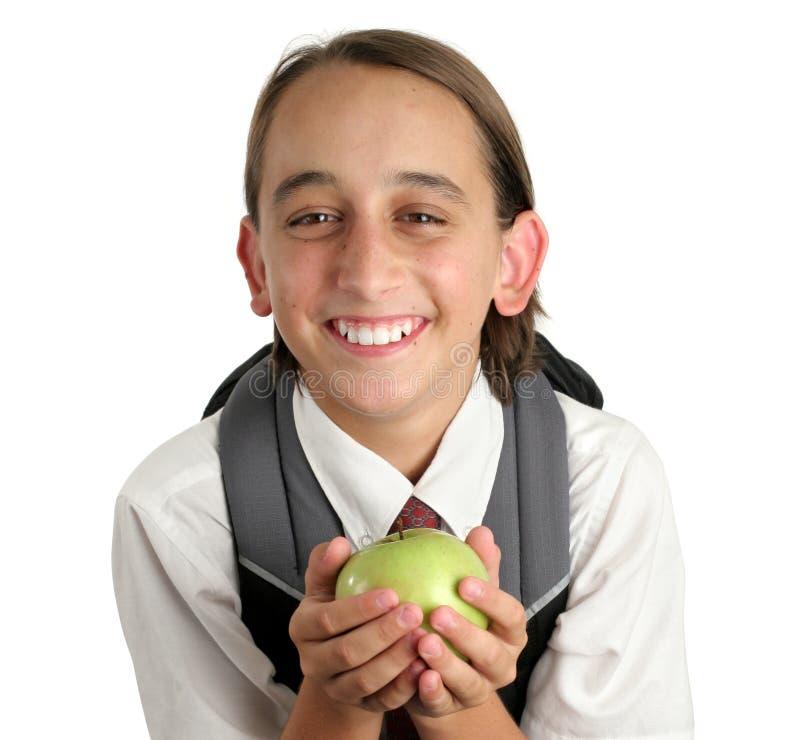 Entzückender Schule-Junge mit Apple stockbild