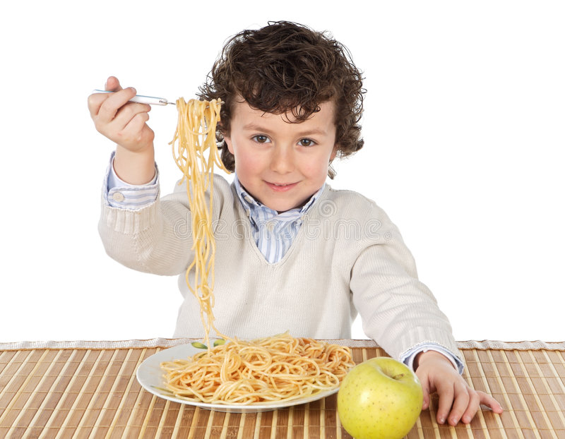 Entzückendes Kind hungrig zu der Zeit des Essens lizenzfreie stockbilder
