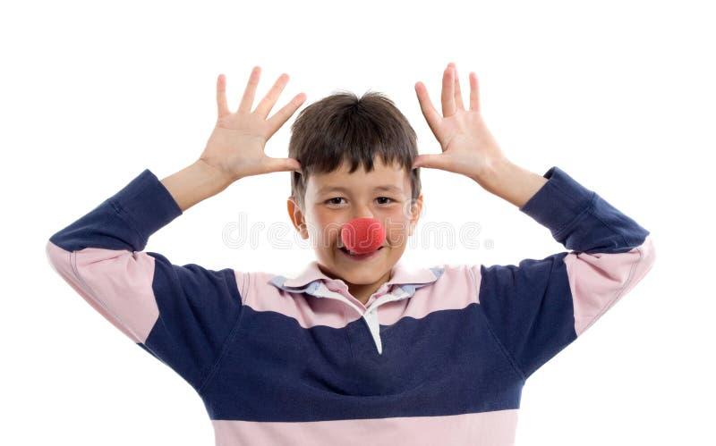 Entzückendes Kind mit einer Clownwekzeugspritze stockbilder