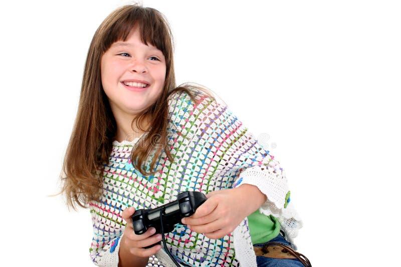 Entzückendes kleines Mädchen, das Videospiele spielt stockbild