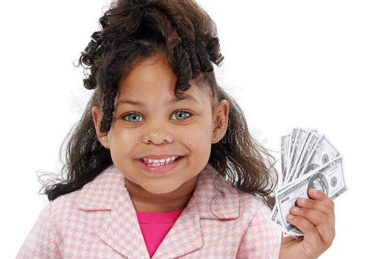 Entzückendes kleines Mädchen und Geld stockfotografie