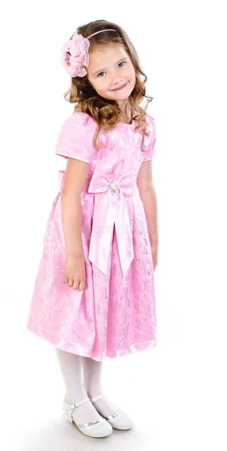 Entzückendes lächelndes kleines Mädchen in rosa Prinzessinkleid lizenzfreies stockfoto