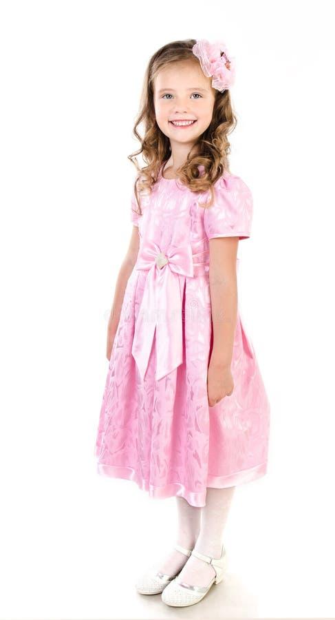 Entzückendes lächelndes kleines Mädchen in rosa Prinzessinkleid lokalisiert lizenzfreie stockbilder