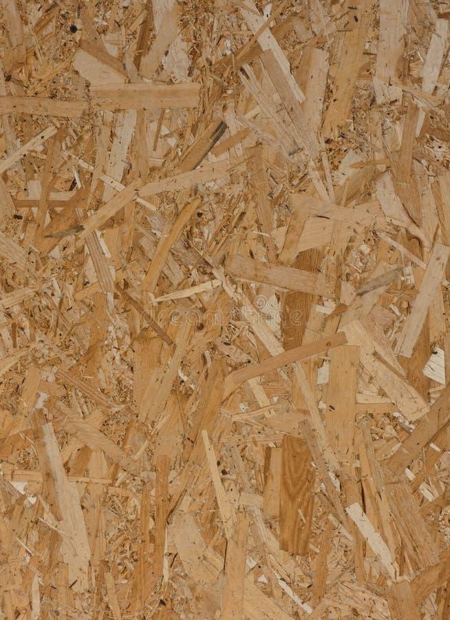 entziehen Sie Hintergrund Gedr?ngte Holzverkleidung, Beschaffenheit der OSB-Platte lizenzfreies stockbild