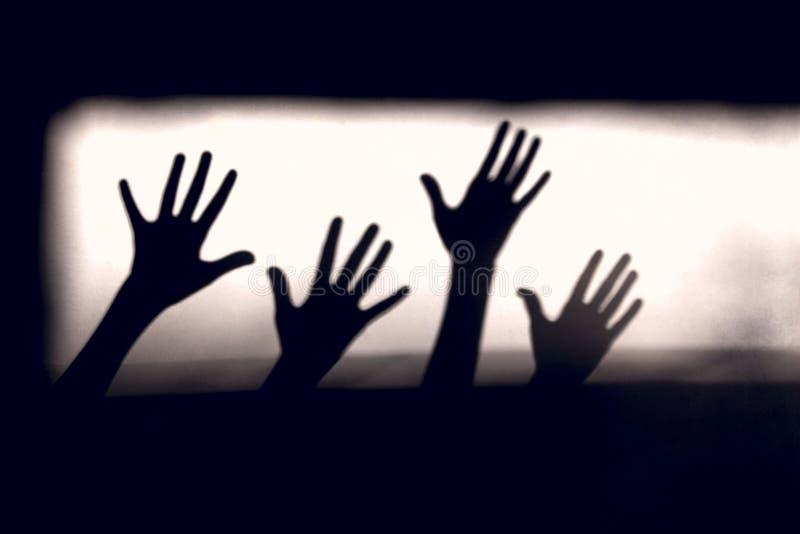 entziehen Sie Hintergrund Schwarze Schatten von Hände auf der Wand lizenzfreies stockbild