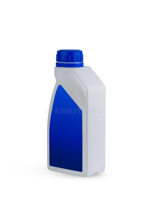 Envase de plástico para el aceite de la máquina aislado en el fondo blanco fotos de archivo