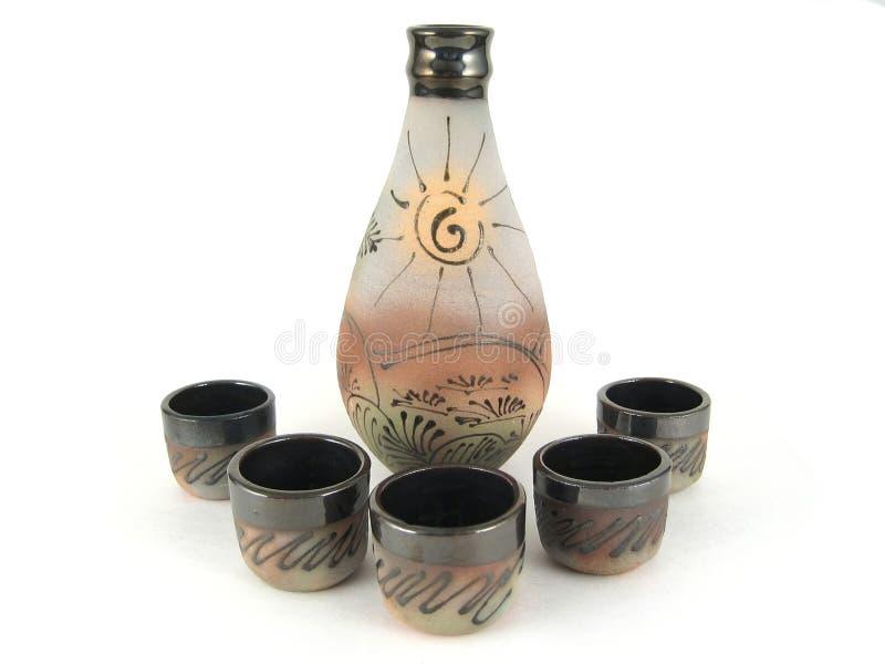 Envase del motivo con las tazas. Aislado foto de archivo libre de regalías