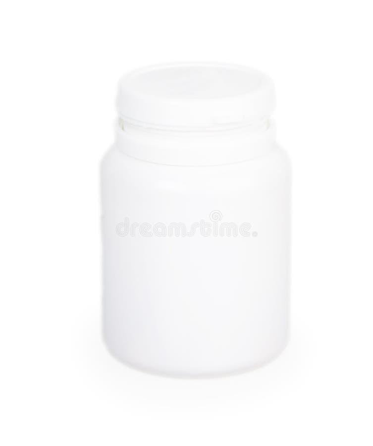 Envase médico plástico blanco cercano para las píldoras imágenes de archivo libres de regalías