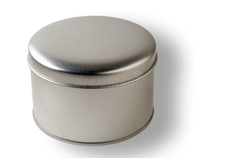 Envase redondo en blanco del metal con el camino de recortes foto de archivo
