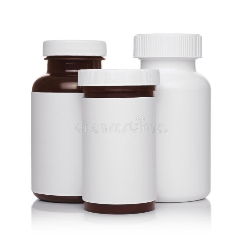 Envases médicos plásticos para las píldoras aisladas fotos de archivo libres de regalías