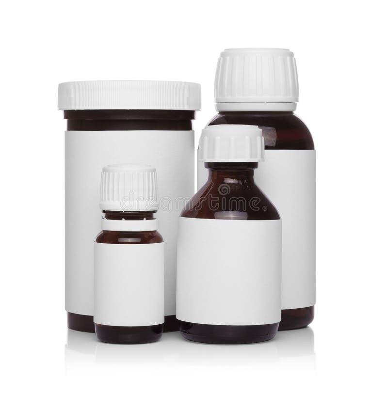Envases médicos plásticos para las píldoras aisladas imagenes de archivo