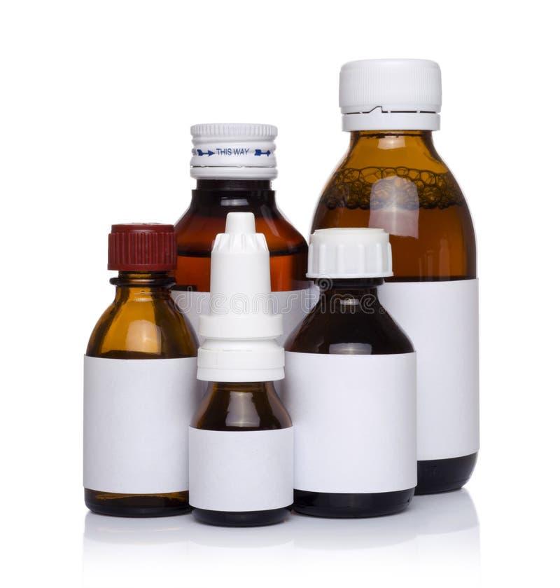 Envases médicos plásticos para las píldoras aisladas foto de archivo