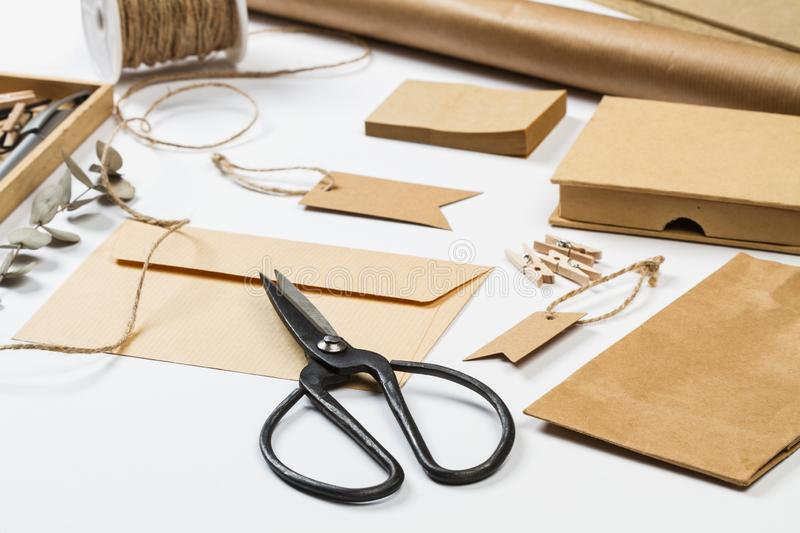 Envelop, boxes, labels and other office stuff. On a white desk royalty free stock photo