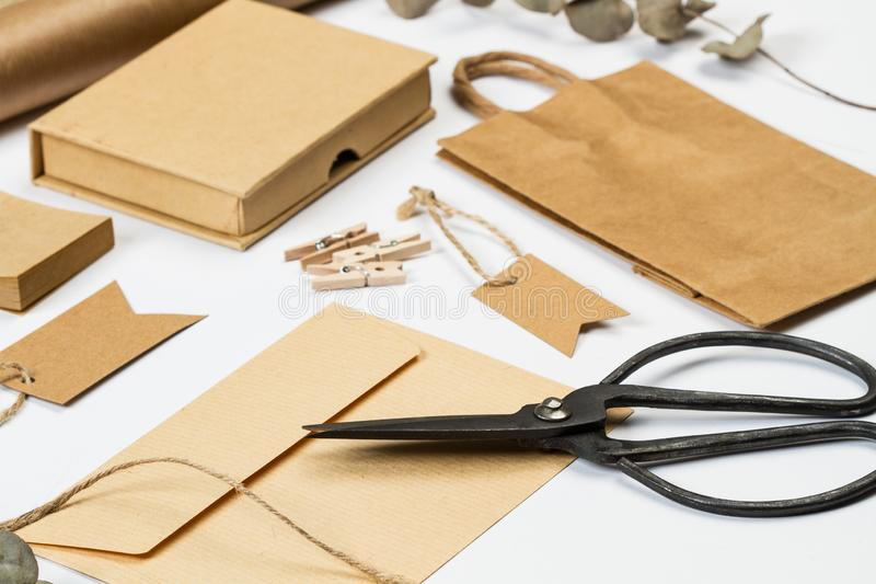 Envelop, boxes, labels and other office stuff. On a white desk stock images