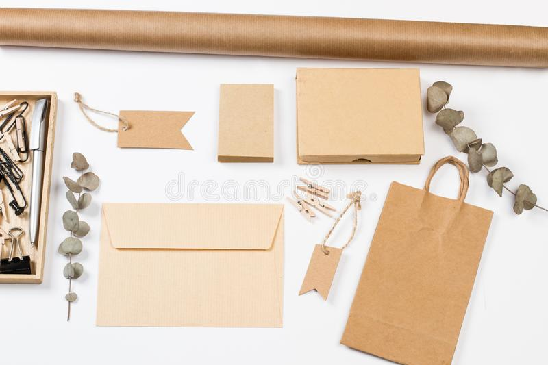 Envelop, boxes, labels and other office stuff. On a white desk royalty free stock image