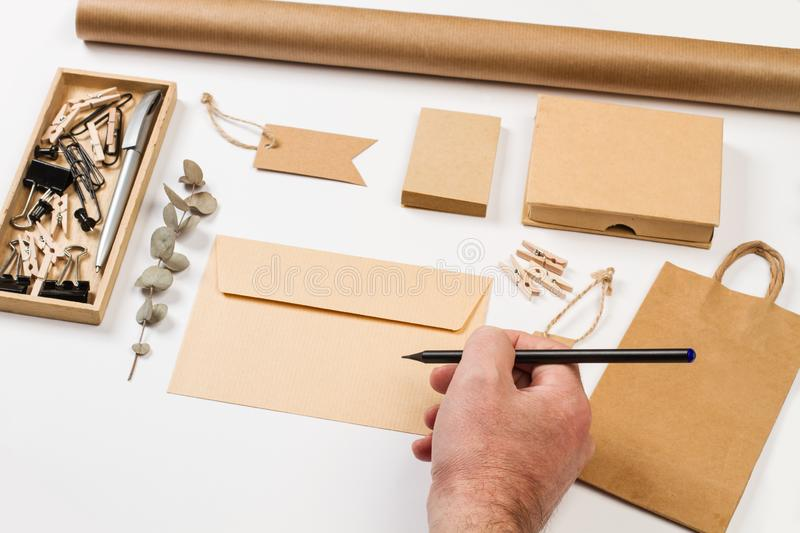 Envelop, boxes, labels and other office stuff. On a white desk royalty free stock photography