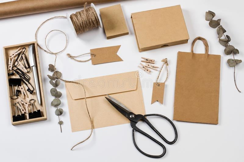 Envelop, boxes, labels and other office stuff. On a white desk stock photos