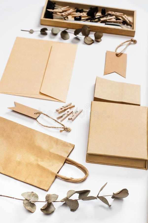 Envelop, boxes, labels and other office stuff. On a white desk stock photography