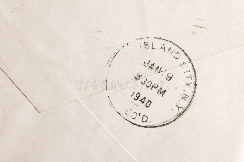 Envelope. Vintage yellowed envelope with postmark stamp royalty free stock photography