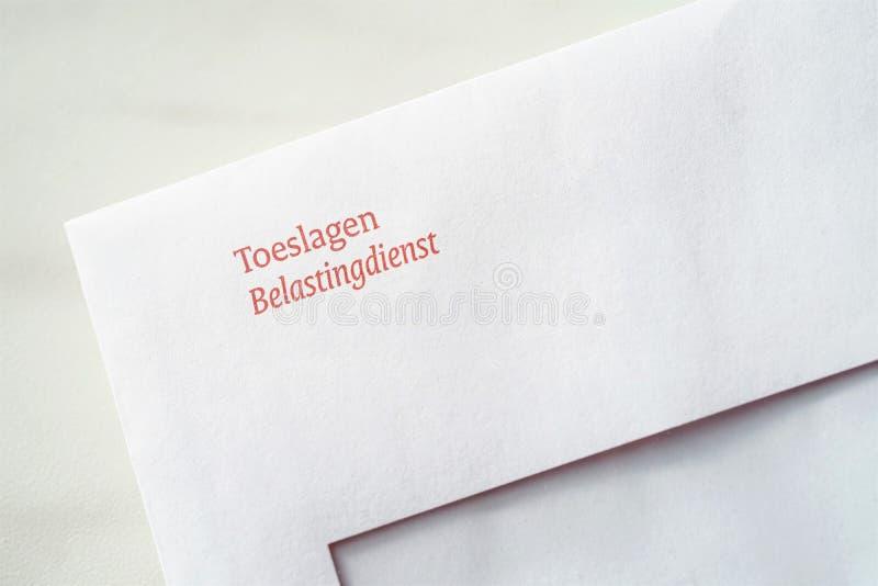 Envelope from the Dutch tax authorities In Dutch: De Belastingdienst regarding allowances In Dutch: Toeslagen. Allowance, belastingdienst, dutch, dutch tax royalty free stock images