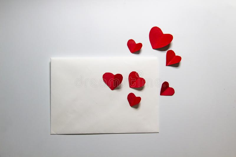 Envelope with a letter and flying hearts. A lover letter. A composition with hearts and letter. A message about love stock images