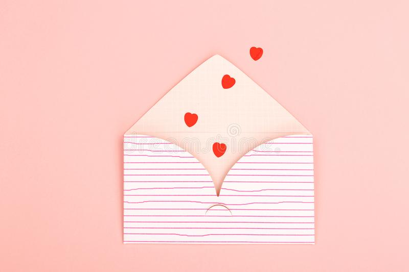 Envelope on pink background stock photography