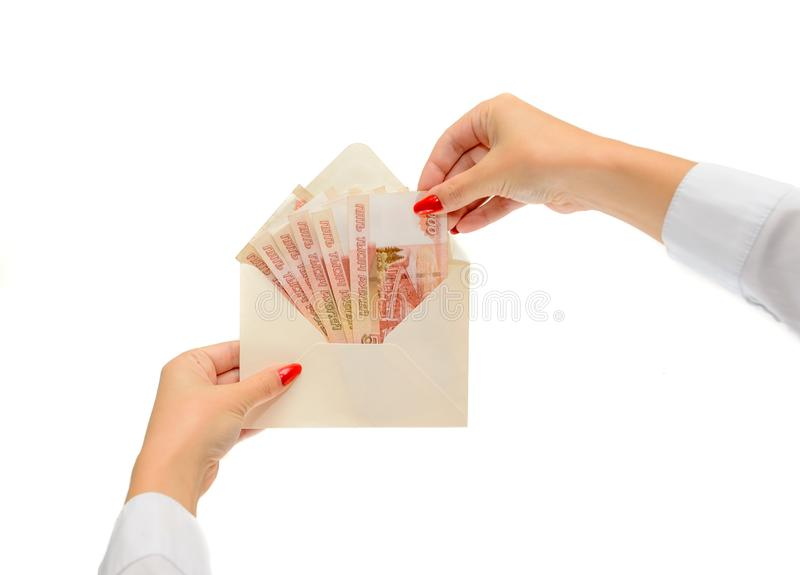 Envelope with Russian money, rubles in the hands of the girl. Banknotes in denominations of 5000 rubles a white envelope in isolation from the background stock photo
