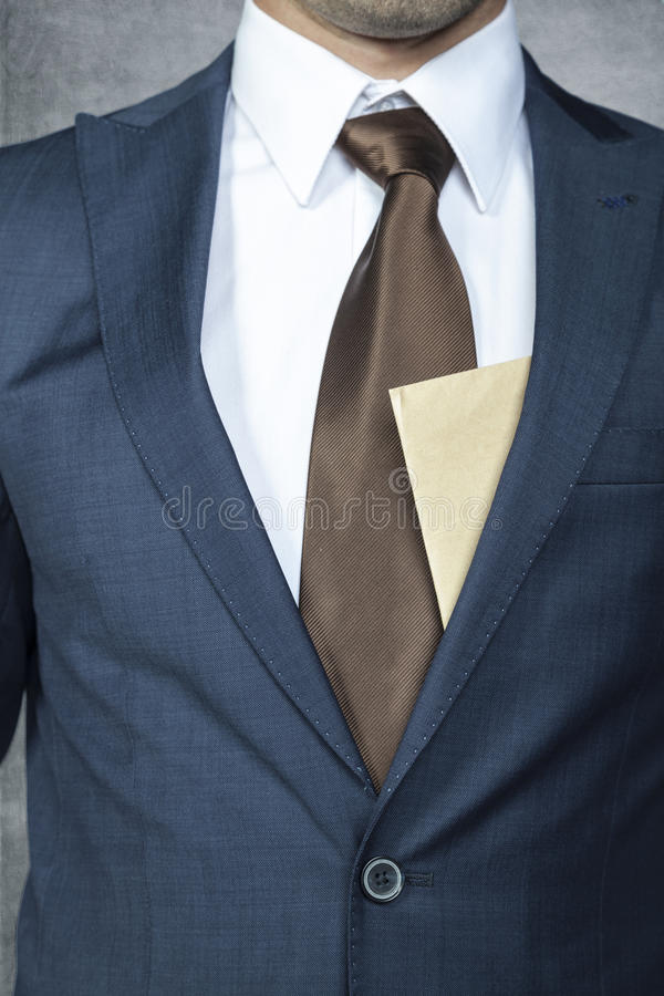 Envelope sticking out from behind the suit royalty free stock photography