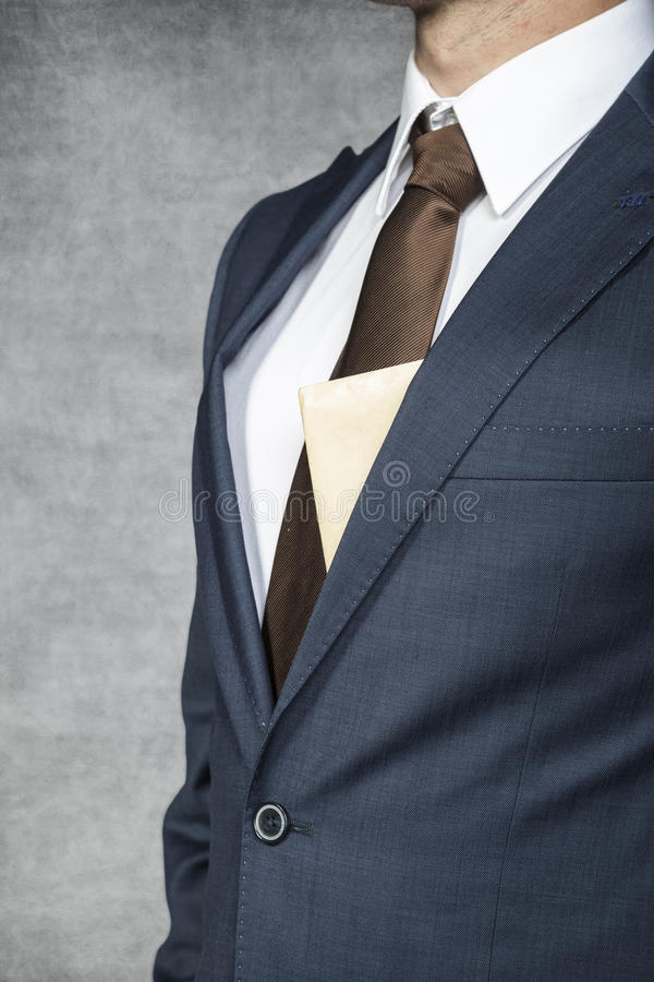 Envelope sticking out from behind the suit royalty free stock images