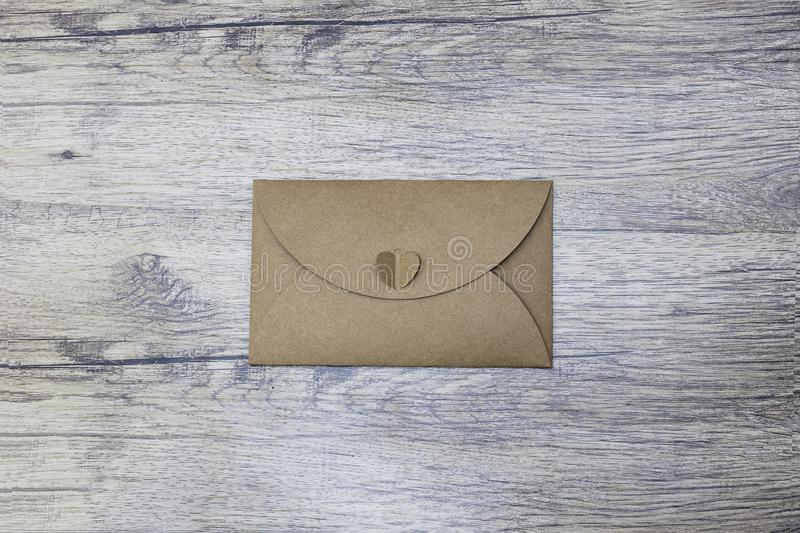 An envelope on wood background. the image represents email, mail, communication royalty free stock images