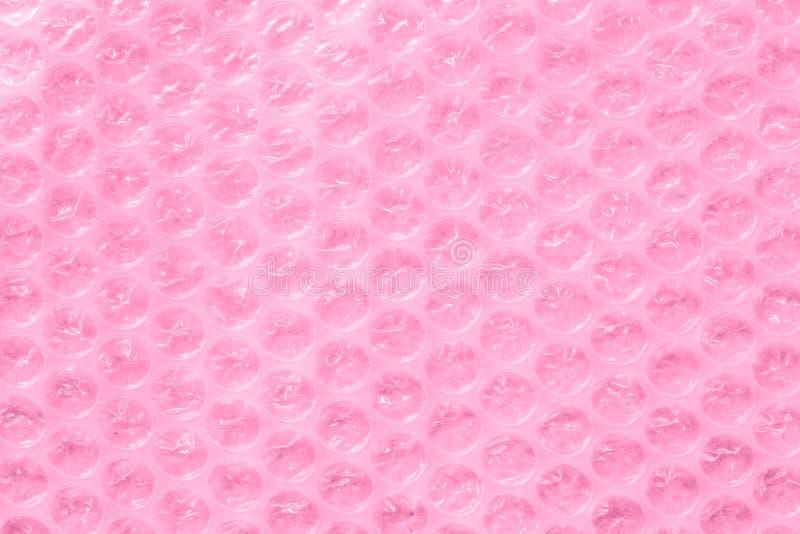 Enveloppe de bulle ou matériel d'emballage rose photographie stock