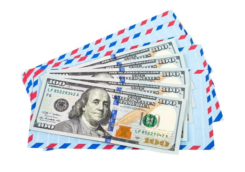 Enveloppen en contant geld in dollars royalty-vrije stock afbeelding