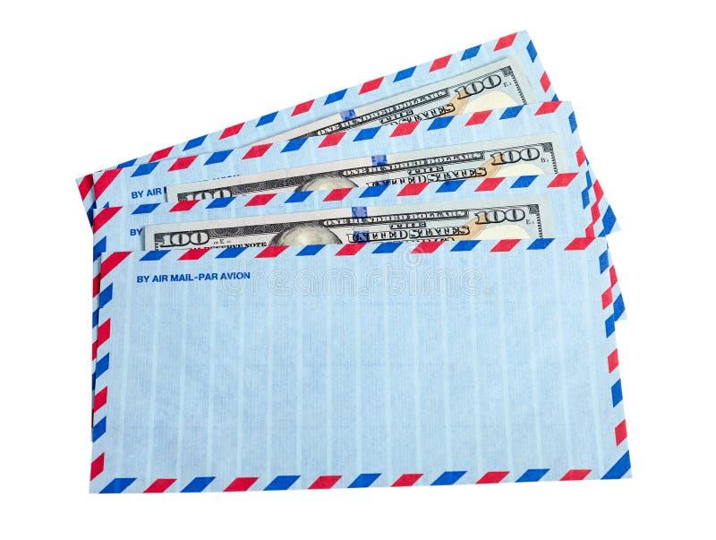 Enveloppen en contant geld in dollars stock afbeeldingen