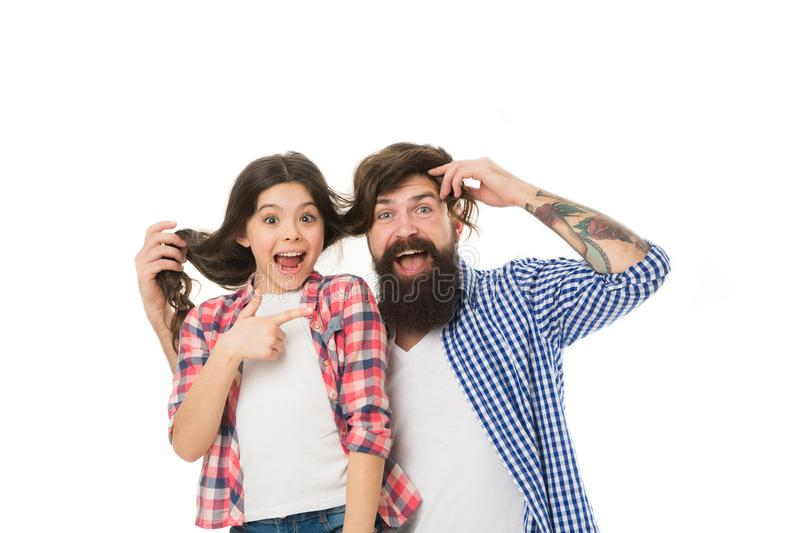 He envies my hairstyle. Man with beard and little girl long hair on white background. Father play with hair of kid. Hairdresser and barber concept. Having fun royalty free stock image