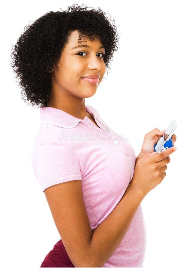 Envio de mensagem de texto africano do adolescente imagens de stock