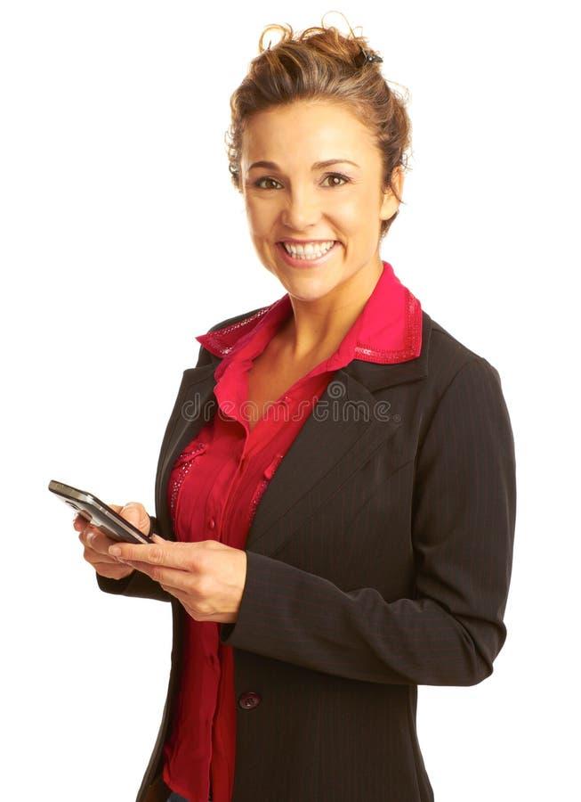 Envio de mensagem de texto bonito da mulher de negócio foto de stock royalty free